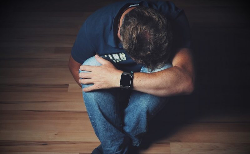 man having pain